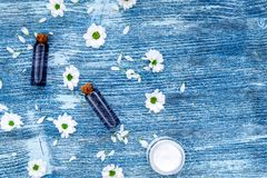 Organic cosmetics with camomile on blue background top view Stock Photography