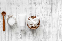 Organic cosmetics with coconut. Coconut cream and oil on wooden background top view copyspace Royalty Free Stock Images