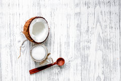 Organic cosmetics with coconut. Coconut oil on wooden background top view copyspace Stock Images
