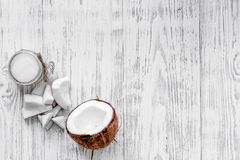 Organic cosmetics with coconut. Coconut oil on wooden background top view copyspace Stock Photography