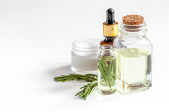 Organic cosmetics with extracts of herbs rosemary on white background Royalty Free Stock Image