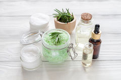 Organic cosmetics with extracts of herbs rosemary on wooden background Royalty Free Stock Photos