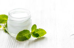 Organic cosmetics with herbal extracts of mint on wooden background Royalty Free Stock Photo