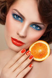 Organic cosmetics. Portrait of young beautiful woman with trendy turquoise and orange make-up Stock Images