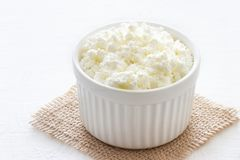 Organic cottage cheese in bowl stock image