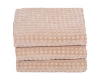 Organic cotton folded bath towels Stock Photos
