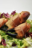 organic crab claws on fresh salad Stock Photography