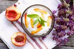 Organic cream with nectarines Stock Image