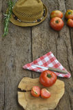 Organic cultivation  red tomatoes on wooden Royalty Free Stock Photography