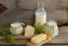 Organic dairy products. On wooden table Stock Photos