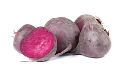 Organic dark red beetroot,  on a white background. Fresh and raw vegetables. Healthful and organic concept. A group of whole red beetroots,  on a white Stock Photos