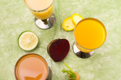 Organic delicious cups of orange juice placed on Stock Photos