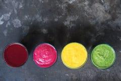 Organic detox smoothies. Top view. Four Organic detox smoothies on stone table. Top view Royalty Free Stock Photos