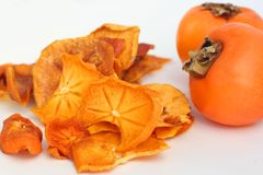 Organic dried persimmon slices Stock Images