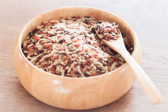 Organic Dry Multi Grain Rice in wooden bowl Royalty Free Stock Image