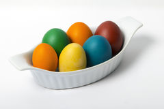 Organic easter eggs in a Casserole. Simple diagonal composition of home-made organic easter eggs in a small casserole Royalty Free Stock Photography