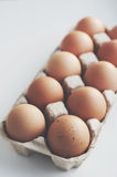 Organic eggs in craft box. Organic brown eggs in craft box Stock Image