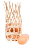 Organic eggs. Out of bamboo basket on white background Royalty Free Stock Photo