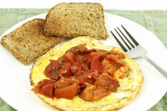 Organic Eggs Toast Tomato. Healthy breakfast with buttered rye bread, protein and fruit with parsley Stock Photography