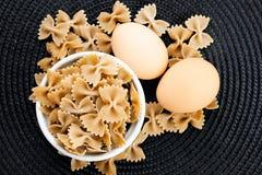 Organic Farfalle pasta and Spaghetti Stock Images