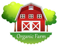 An organic farm label with a red wooden house Royalty Free Stock Image