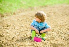 Organic farm. planet protection. small kid planting flower. ecology life. eco farm. human nature. earth day. summer farm. Happy child gardener. plant nursery stock images