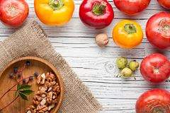Organic farm tomatoes on wooden background  top view, frame, cop Royalty Free Stock Images