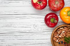 Organic farm tomatoes and sweet pepper on wooden background  top Royalty Free Stock Images