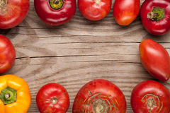Organic farm tomatoes and sweet pepper on wooden background  top Royalty Free Stock Image