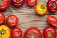 Organic farm tomatoes and sweet pepper on wooden background  top Stock Images