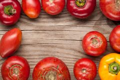 Organic farm tomatoes and sweet pepper on wooden background  top Stock Photos