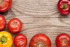 Organic farm tomatoes and sweet pepper on wooden background  top Royalty Free Stock Photo