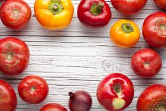 Organic farm tomatoes on wooden background  top view, frame, cop Stock Photo