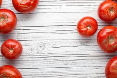 Organic farm tomatoes on wooden background  top view, frame, cop Royalty Free Stock Photo