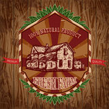 Organic farm vintage poster with farmhouse on the background texture of wooden boards. Royalty Free Stock Image