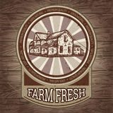 Organic farm vintage poster with farmhouse on the background texture of wooden boards. Stock Photos