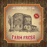 Organic farm vintage poster with farmhouse on the background texture of wooden boards. Retro hand drawn vector illustration in sketch style Royalty Free Stock Photography