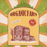 Organic farm vintage poster with farmhouse on the background texture of wooden boards. Retro hand drawn vector illustration in sketch style Stock Image