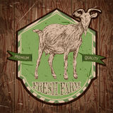Organic farm vintage poster with goat on the background texture of wooden boards. Stock Images