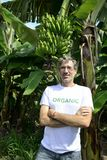 Organic farmer in front of banana plantation Stock Photos
