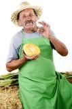 Organic farmer with a half honeydew melon Royalty Free Stock Photography