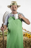 Organic farmer with a pitchfork Royalty Free Stock Photography