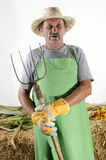 Organic farmer with a pitchfork Stock Image