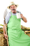 Organic farmer with a pitchfork and a beer mug Stock Images