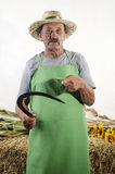 Organic farmer with a small sickle in his hand Royalty Free Stock Images