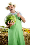 Organic farmer with a water melon Stock Photo