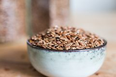 Organic fibre nutrition linseed flaxseed. Grain cereal in bowl on wooden table stock photos