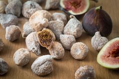 Organic figs. Dried and fresh. Organic sweet juicy dried and fresh figs on a cutting board stock photo