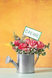 Organic flowers in a watering can Royalty Free Stock Photo