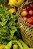 Organic food. Close up of organic vegetables and fruits in the basket Stock Photos